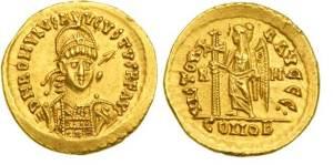 mynt med den siste kejsarens bild.
